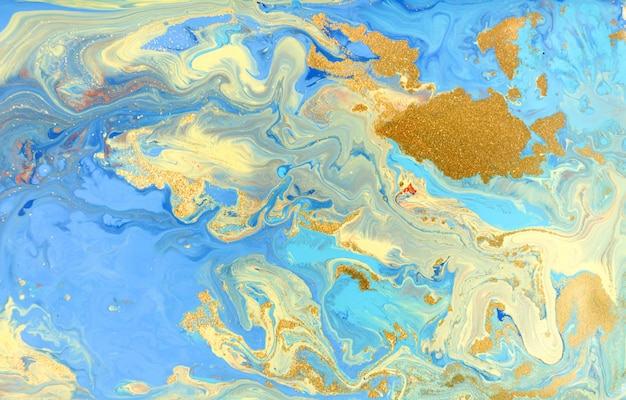 Blaues und gelbes marmormuster mit goldenem glitter. abstrakter flüssiger hintergrund