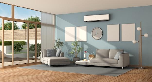 Blaues und graues wohnzimmer einer modernen villa