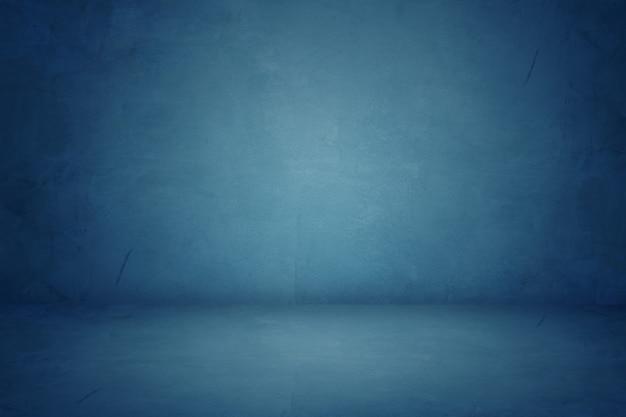 Blaues zementstudio und dunkler ausstellungsraumhintergrund