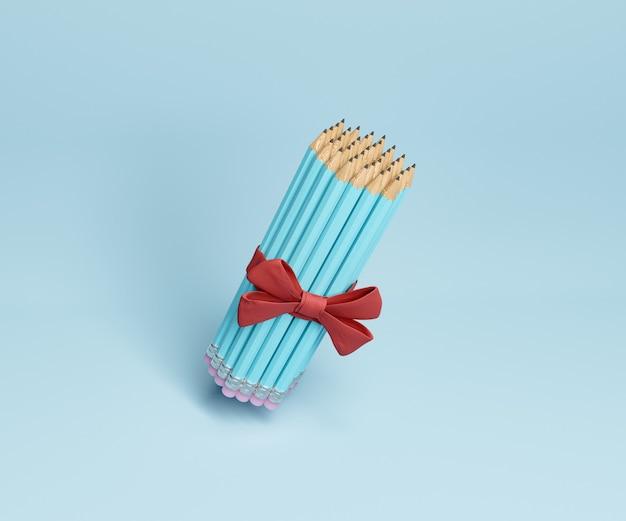 Bleistifte verziert mit rotem geschenkband