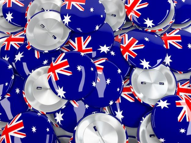 Blick von oben auf den stapel von button-abzeichen mit flagge von australien. realistisches 3d-rendering Premium Fotos