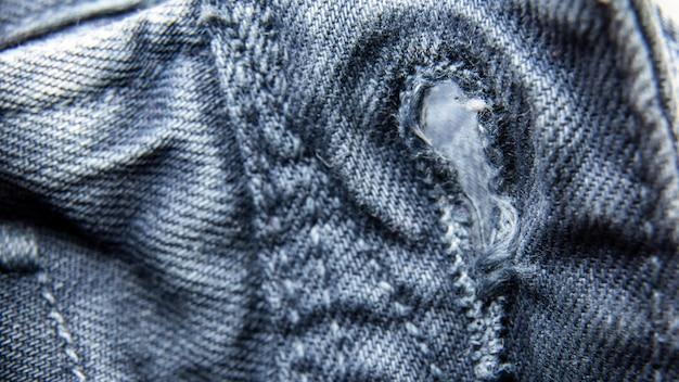 Blue jeans-gewebe- / denimjeansbeschaffenheit oder denimjeanshintergrund.
