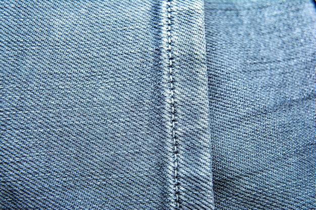 Blue jeans-hintergrund / jeansbeschaffenheit. mit tasche
