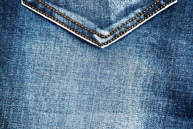 Blue jeans stoff textur mit tasche für hintergrund und muster