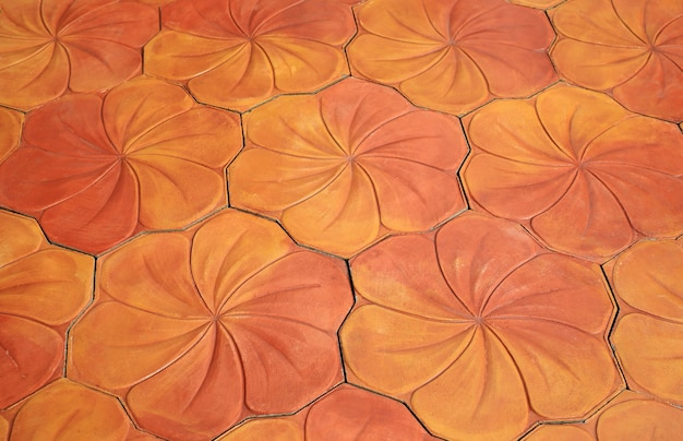 Blumen fliesen textur als hintergrund. frangipani- oder plumeria-blume. perspektivische ansicht