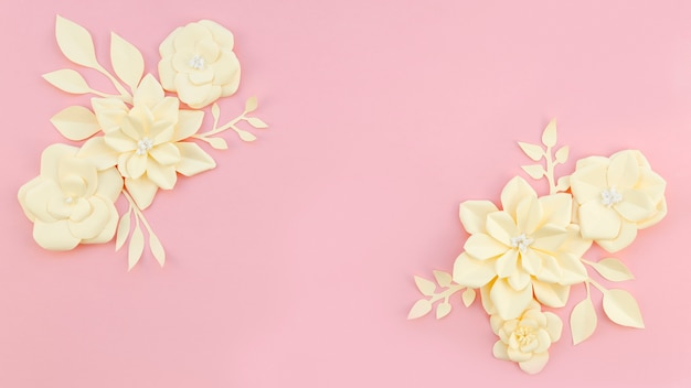 Blumenrahmen auf rosa hintergrund