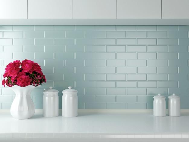 Blumenvase mit dekoration auf weißer küchenarbeitsplatte