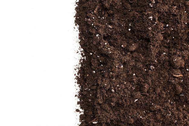 Boden- oder schmutzabschnitt lokalisiert auf weißem hintergrund
