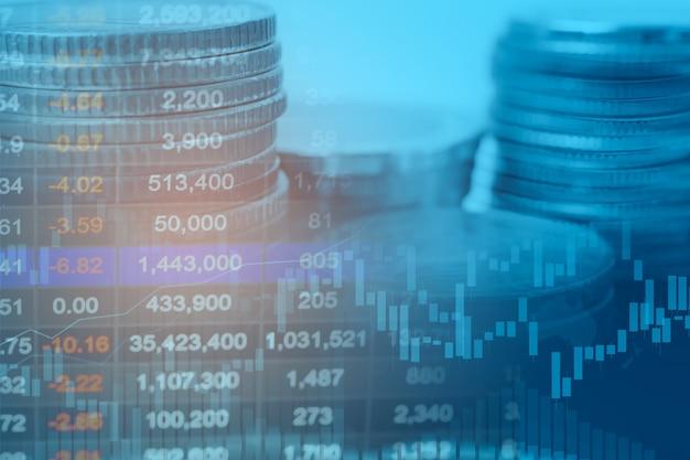 Börseninvestitionshandel mit finanzmünzen und grafikdiagrammen