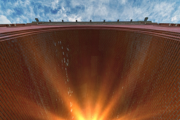 Bogen aus rotem backstein. sonnenlicht am ende des tunnels.