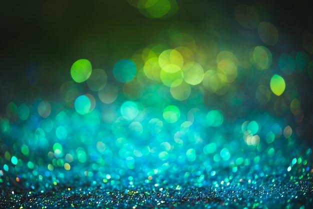 Bokeh-effekt glitzer bunter verschwommener abstrakter hintergrund für geburtstag, jubiläum, hochzeit, silvester oder weihnachten.