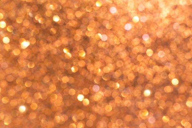 Bokeh lichter von goldrosa, defokussiertem funkeln
