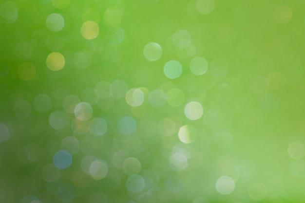 Bokeh-muster auf olivgrünem hintergrund