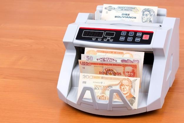 Bolivianer boliviano in einer zählmaschine