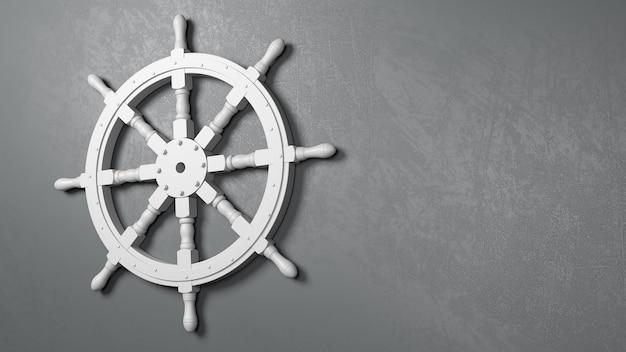 Bootsruderrad gegen eine graue wand