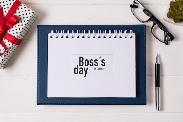 Boss tagesarrangement mit notizblock
