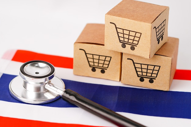 Box mit warenkorb-logo und stethoskop auf thailand-flagge: import export shopping online oder e-commerce-finanzlieferdienst shop produktversand, handel, lieferantenkonzept.