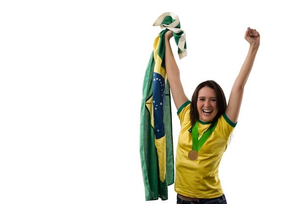 Brasilianische sportlerin, die eine goldene medaille gewinnt