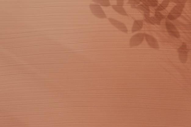 Braune acrylstruktur mit blattschatten