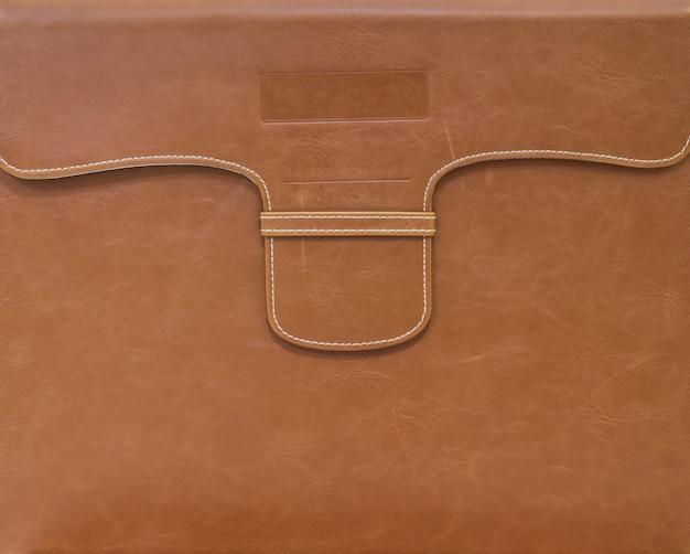 Braune tasche für dokumentenpapierhintergrund
