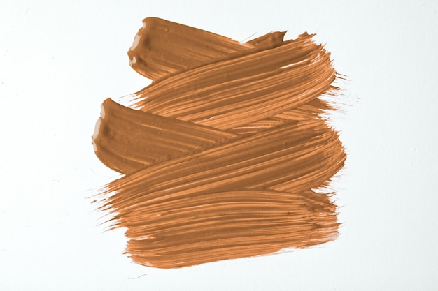 Braune und weiße farben des abstrakten kunsthintergrundes. aquarellmalerei auf leinwand mit beigen strichen und spritzern. acrylbild auf papier mit bronzemuster. textur-hintergrund.