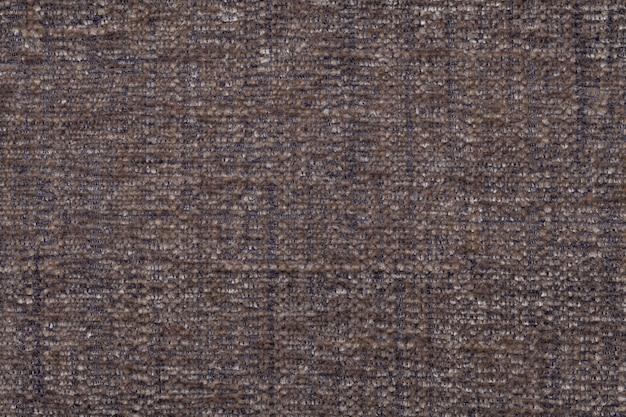 Brauner flauschiger hintergrund des weichen, flauschigen stoffes. textur der textilen nahaufnahme