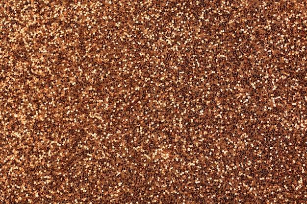 Brauner glitzer-texturhintergrund, glitzer- oder sandpapper-hochdetaillierte oberfläche, leuchtendes konzeptfoto mit leuchtenden effekten