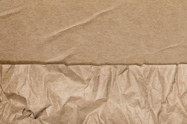 Brauner hintergrund mit zerknitterten papierstruktur-remixed-medien