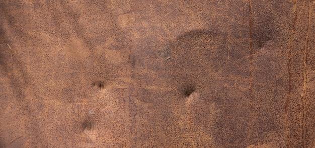Brauner hintergrund von der rostigen platte
