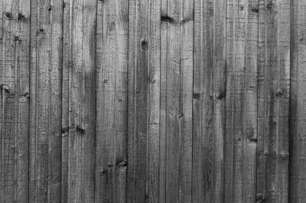 Brauner holzbeschaffenheitshintergrund, der vom natürlichen baum kommt. die holzplatte hat ein schönes dunkles muster, eine hartholzbodenstruktur