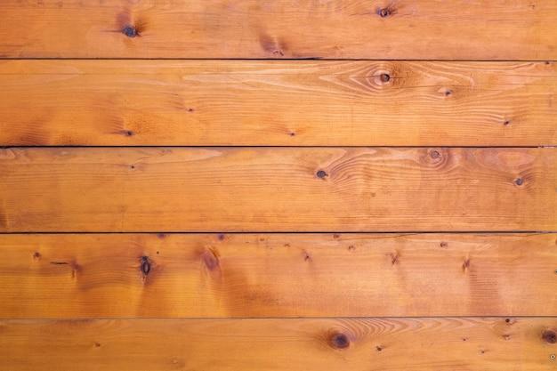 Brauner holzhintergrund mit dem nagel im weinlesestil, holzwand des landhauses des bauern