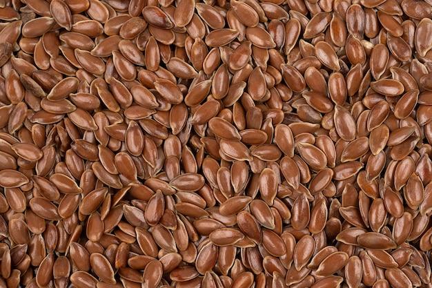 Brauner leinsamen-hintergrund leinsamen sind eine gute quelle für omega-3-fettsäuren, die die verdauung unterstützen können