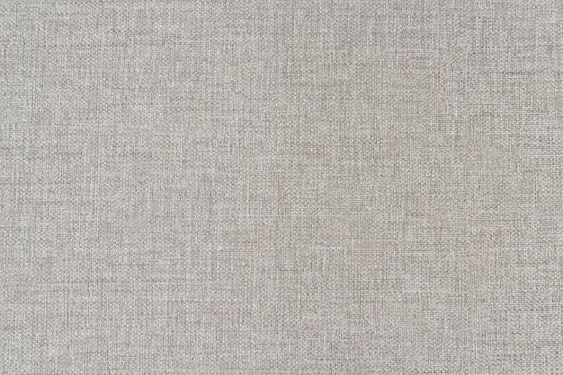 Brauner leinwandtexturhintergrund. kleine textur