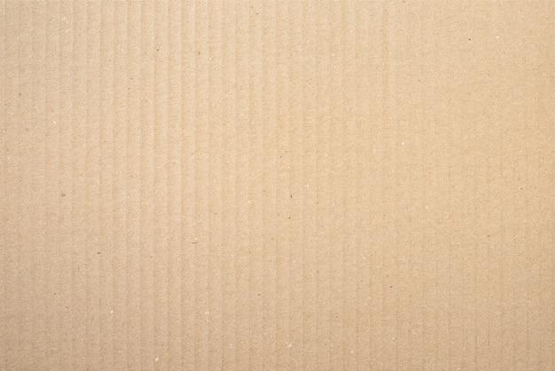 Brauner papierbeschaffenheitshintergrund oder pappoberfläche von einer papierbox zum verpacken.