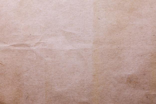 Brauner papierbeschaffenheitshintergrund