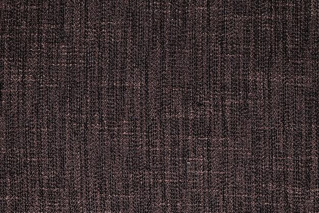 Brauner stoffteppich mit strukturiertem hintergrund
