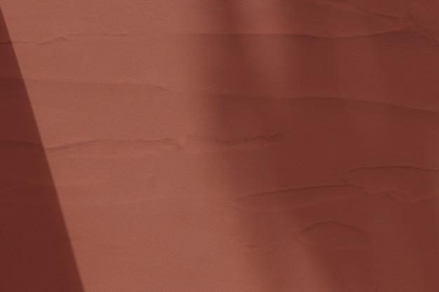 Brauner strukturierter hintergrund mit schatten