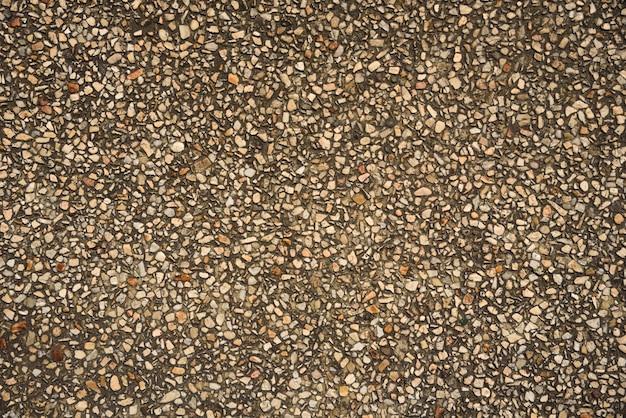 Brauner und weißer stein im zement auf beschaffenheit und hintergrund