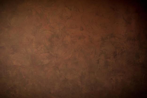 Brauner wandhintergrund und textur