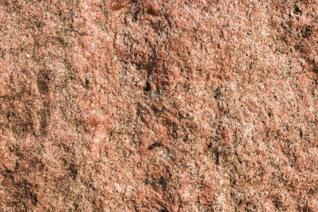 Breiter sandiger rötlicher steinbeschaffenheitshintergrund für entwürfe