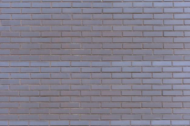 Brik-wand-hintergrund. dunkle textur der steinmauer. schwarze ziegelwand. alte backsteinmauer schwarz und weiß