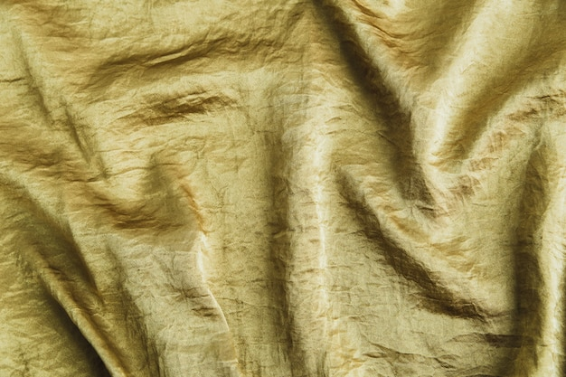 Bronze eleganter seidenstoffhintergrund mit wellen.