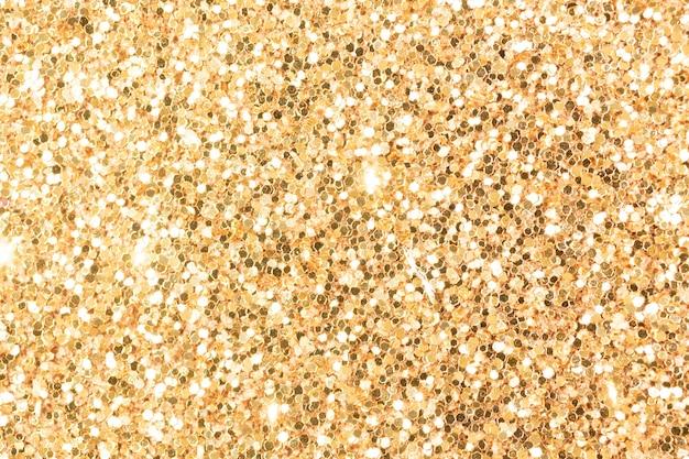 Bronze glänzendes leuchtendes effektkonzept, glitzertexturhintergrund, sandpapper hochdetailliertes oberflächenfoto