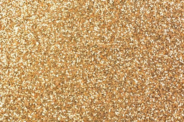 Bronzeglitter textur hintergrund, glitzer oder sandpapper hochdetaillierte oberfläche, leuchtende leuchtende effekte konzeptfoto