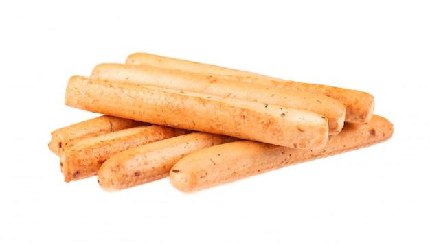Brotstangen isoliert auf weiß. grissini, italienische grissini mit zwiebeln und kräutern.