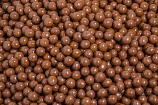 Brown dragee, nüsse mit schokoladenüberzug, hintergrund