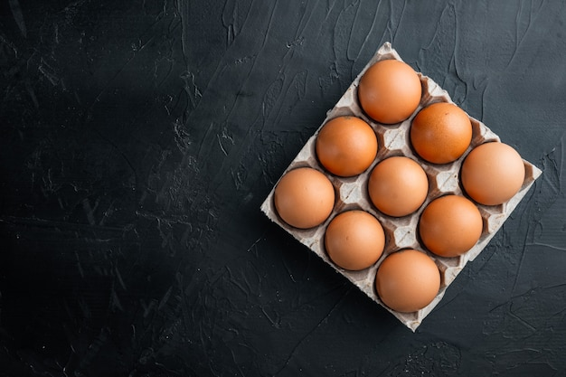 Brown eier in kartonschachtel draufsicht flach legen