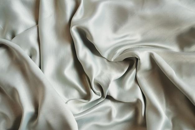 Brown-sahnesatin oder seidenhintergrund mit textilbeschaffenheit