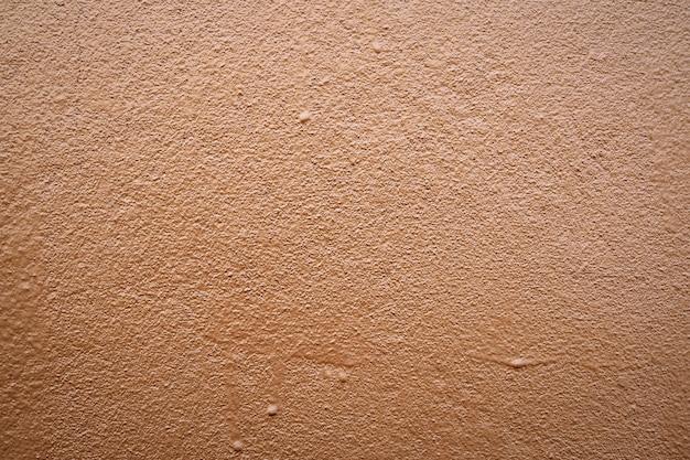 Brown-zementwand-beschaffenheitshintergrund