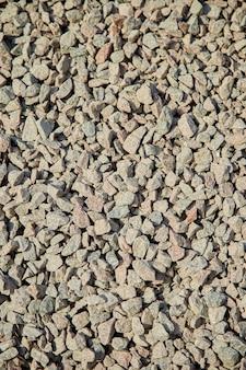 Bruchsteinhintergrund, ein stapel des zerquetschten steins.